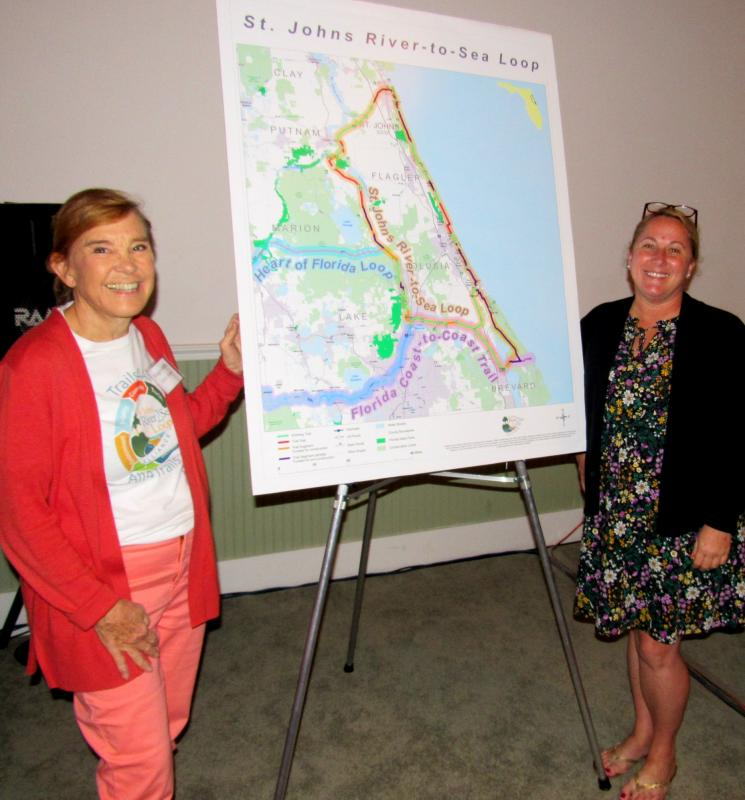Maggie Ardito and Danielle Anderson admire River to Sea Loop Map